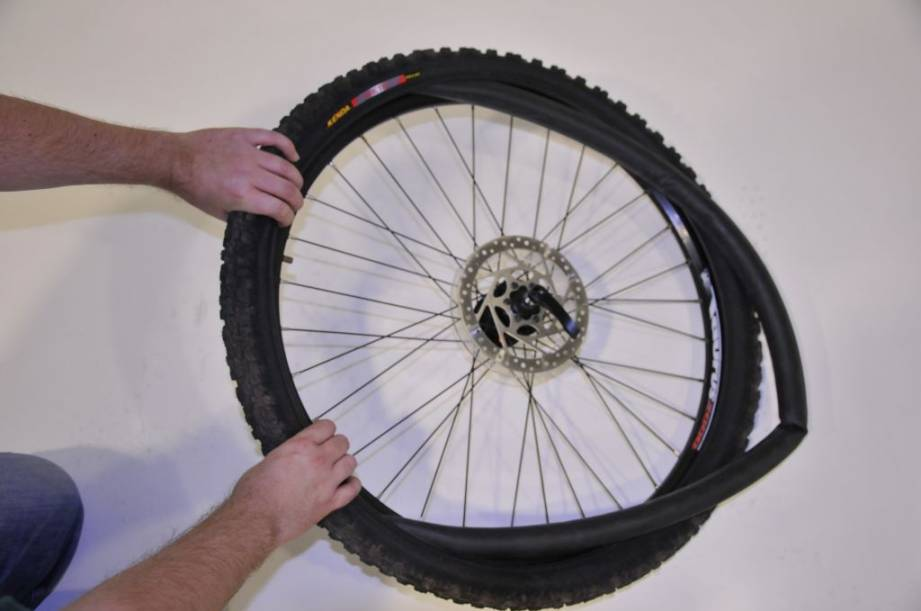 checking the tube of a punctured bike tyre
